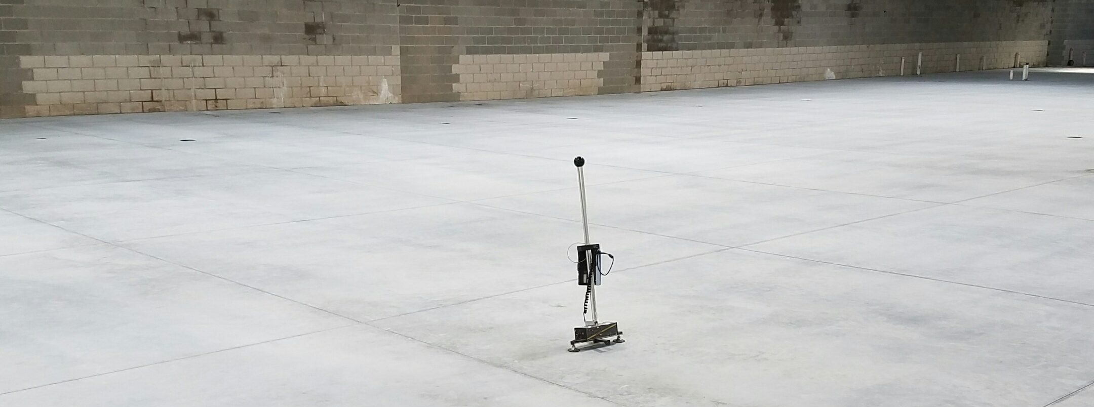 Floor flatness device